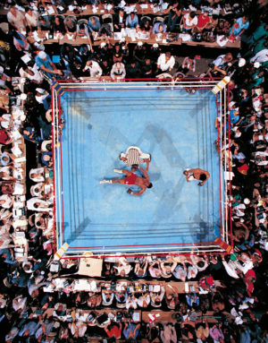 Seven years after being stripped ol his title, Muhammad Ali, champion again at 32. Boxing history is made as Foreman fails to get up from the canvas. The referee was former Harlem Globetrotter, Zack Clayton. photo by Nell Lener